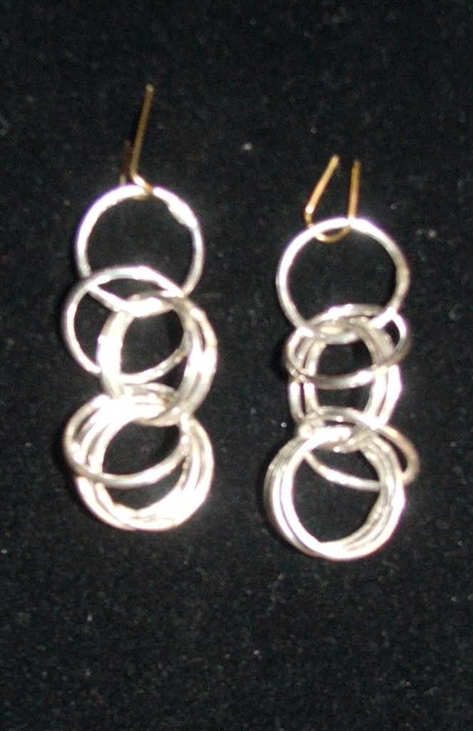 Earrings - the body is fine silver.  Handmade ear wires and eclectic bangles to come.  By Tammy Vitale.