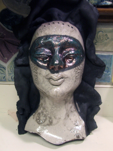 Raku mask - cleaned up but not yet finished - by Tammy Vitale