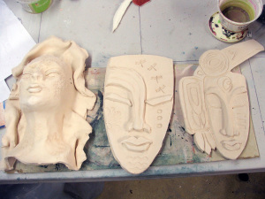 3 masks by Tammy Vitale, bisque-fired for raku.  the middle will go into the fire 11/22 and we'll see about the others after that.