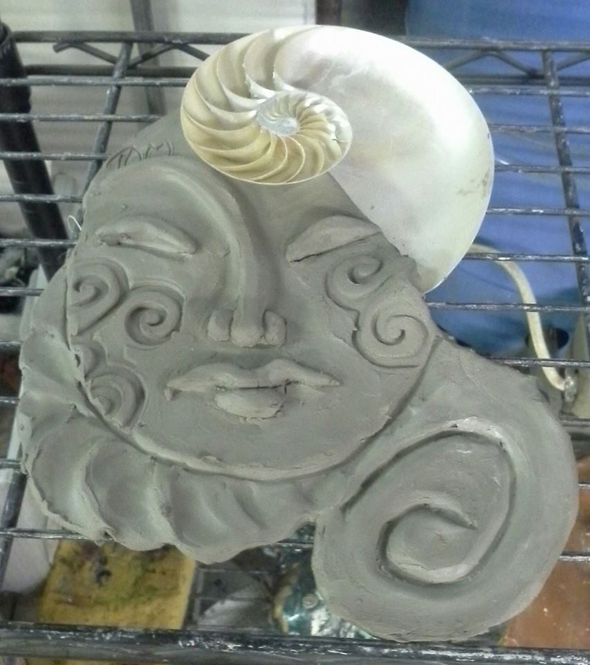 mask for raku with nautilus shell